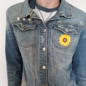 Distressed Jean jacket with flower patches